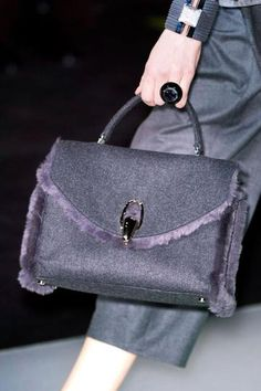 GIORGIO ARMANI: A wool bag trimmed in shearling? Too perfect for words.