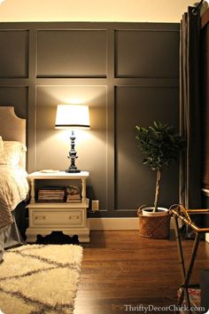 Adding a dark gray accent wall and board and batten to the master bedroom creates something amazing. #DIY #accentwall Credenza, Oversized Mirror, Master Bedroom, Dining Room, Cabinet, Lighting, Furniture, Home Decor, Bed Room