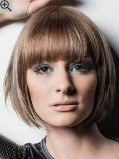 Round bob with the sides layered to gently curve in. The bangs are darker than the rest of the hair.
