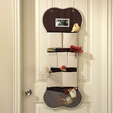 Over the door dog gear organizer! Great for holding collars, leashes, treats, poop bags, etc... All in one spot!