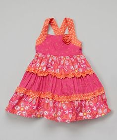 The light, flowing skirt and soft cotton will keep a little lady comfy all day, while racerback straps slip on with ease. Note: Only infant sizes include diaper cover.