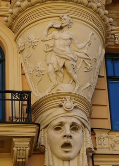 Art Nouveau pillar detail.  I wonder if each pillar top has a different motif or theme.