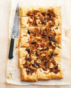 Fabulous French Appetizer Recipes That Bring the Bistro Home - Our puff-pastry take on the pizzalike pissaladiere has slivered olives, anchovies, and plenty of onions. Using frozen puff pastry means it's perfect for last-minute get-togethers or casual cocktails.
