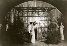Gordon Wildes, a 1935 graduate, and Evy Law are under the arch at the 1934 Ring Dance.