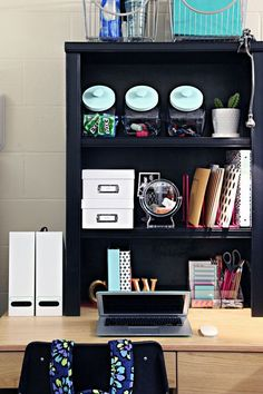 Add a Hutch (small bookcase) to you Dorm Desk to give you more vertical storage. Spray paint a kitchen cabinet organizer to become a file and binder holder, gold painted letters were added to basic metal bookends to give a personalized touch, penny jars from Target are a fun way to store items.