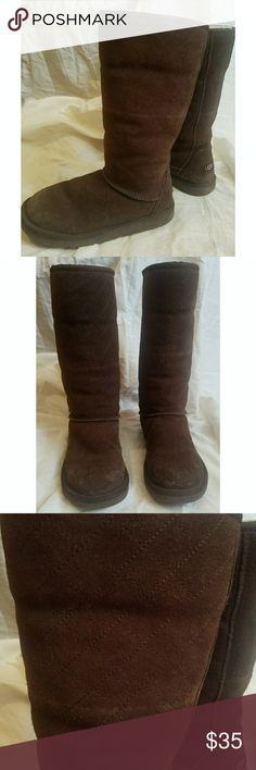 Uggs tall, brown quilted 6 Tall brown sheepskin UGG boots, quilted in a diamond pattern, size 6,condition is used but very good, some wear to the leather outside, inside is near perfect. These are older but still very nice. *My items are NOT from a smoke free home* UGG Shoes Ankle Boots & Booties