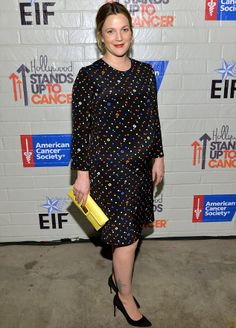 Colourful figure: Pregnant Drew Barrymore looked pretty in her clinging black dress decorated with multi-coloured spots as she arrived at th...