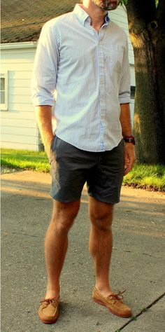 Shop this look for $127:  http://lookastic.com/men/looks/white-and-blue-longsleeve-shirt-and-brown-leather-boat-shoes-and-charcoal-shorts/44  — White and Blue Gingham Longsleeve Shirt  — Brown Leather Boat Shoes  — Charcoal Shorts