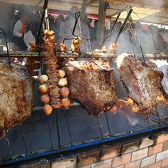 In Brazil, it's nearly impossible to avoid eating churrasco, the country's version of grilled meat, which is cooked over hot coals. In restaurants (or churrascaria), it is generally served by waiters bringing a spit or large skewer of meat directly to the table. Servers will come back again and again with different meats and cuts, piling diners' plates high until they've had their fill.
