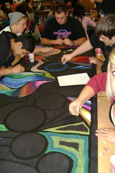 Teacher works out the overall design and students fill in...like working with a Resident Artist.