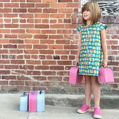 Travel in style with this cute little travel inspired, completely reversible a-line dress with capped sleeves