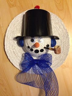 Paint a straw hat, use corncob pipe, buttons, googly eyes, cut party hat and more to make a snowman