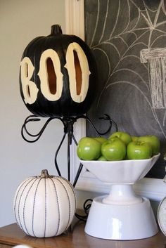 Embellished and painted black and white halloween pumpkins. I love everything about her Halloween decor!!!