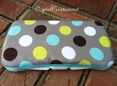This adorable travel baby wipe case is fully covered in a modern polka dot print, The case is trimmed with coordinating ribbon in aqua blue. The top is slightly padded. This print is perfect for a little boy! Baby Wipe Case, Wipes Case, Traveling With Baby, Polka Dot Print, Fabric Covered, Baby Ideas, Aqua Blue, Little Boys, Sunglasses Case