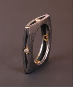 "Ring | Maria Samora.  ""Square collection"".  Sterling silver oxidized with diamonds set in 18k gold"