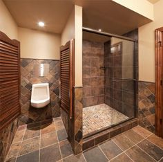 Basement bathroom with swinging doors to the bidet
