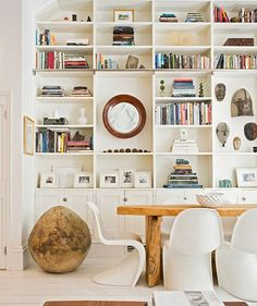 Built-in white shelf & cabinets.