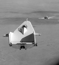 """NASA M2-F1 """"Flying Bathtub"""" was a wingless lifting body testbed. It had a plywood frame and no engine. It took off under tow, initially from a Pontiac Catalina and eventually"""
