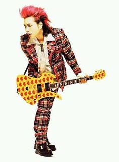 Beloved Japanese rockstar, Hide Matsumoto, with his signature Fernandes Burny, a splendid, psychedelic little guitar. I can't show it to you up close in case your kids are sitting next to you, but suffice it to say, it clearly reflects Hide's eccentric personality. This man was a national treasure of Japan, like Michael Jackson or Whitney Houston, for the U.S. Like these great artists, he died tragically young and will be forever missed. R.I.P. Rock in Perpetuity, Hide.