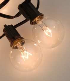 "Lantern Lights Clear Bulbs (48"" spacing) 10 Sockets Black Cord (40.5') $26 set / 3 for $25 set (for 12"" -30"" lanterns)"
