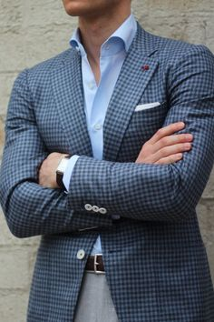Gingham jacket with popping white buttons. Blue shirt.