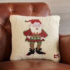 """MR. ELF HOOKED PILLOW - A Sundance holiday must-have, this plush and hearty hooked wool pillow is designed by Vermont artist Laura Megroz, lending homey warmth to any room. Backed in cotton velveteen with hidden zipper closure. Polyfill insert. Imported. Exclusive. 18"""" sq."""