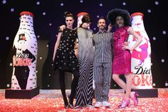 Marc Jacobs poses with models Eliza Cummings, Lily McMenamy and Ginta Lapina as he unveils his Diet Coke bottle designs