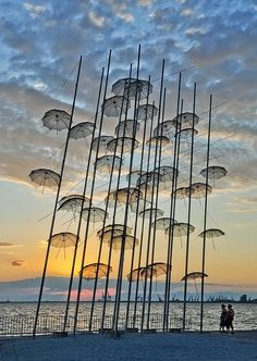 "The ""Umbrellas"", a work of art by Giorgos Zoggolopoulos, on the promenade of Thessaloniki, Greece, photo by Kisha Buenaventura"