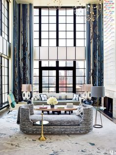 Interior designer Jean-Louis Deniot created a lyrical New York pied-à-terre for a family based in Paris and Aspen, Colorado. In the double-height living room, a Deniot-designed daybed covered in a Métaphores fabric and accented by an Hermès throw is joined by several vintage pieces, including an Ado Chale cocktail table, a FontanaArte side table, and an Edward Wormley sofa.