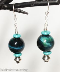 Patient Communication Earrings Patience, Manifestation, Grounding balance between extremes, discernment, practicality, vitality, strength, fairness combined with clear communication.  Teal tiger eye, turquoise, sterling silver  $35