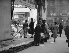 Christmas in wartime: Sandbags are placed outside the shop window at Selfridges to protect it during the first Christmas of World War II in 1939