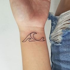 This simplified wave tattoo is for all the ocean lovers.