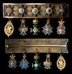 Miniature riband bar, worn by Duke William of Brunswick (1830-84), c. 1850, width of bar 84mm, with badge and star of the following: BRUNSWICK Order of Henry the Lion; PRUSSIA Order of the Black Eagle; AUSTRIA Order of St Stephen; RUSSIA Order of St Andrew; GREAT BRITAIN Order of the Garter.