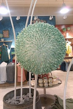 Anthropologie flower flower balls on long stalks made from dyed q-tips stuck into foam balls!