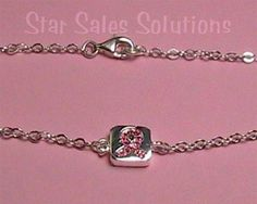 This beautiful breast cancer awareness bracelet has a classy and simple design.  It is made of genuine sterling silver and has a link design.  Lobster clasp closure.