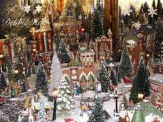 a section of my own debbie holt dept56 christmas in the city village display christmas villages pinterest christmas villages display and