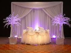 Sweetheart table in purple and white and crystal trees and LED lighting. Get more help. http://memory-lane.mybigcommerce.com