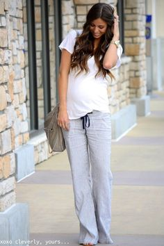 #Bump style. This look proves that you don't need to dress up to look great while #pregnant! Cozy sweats and a white tee paired with a smile = FAB