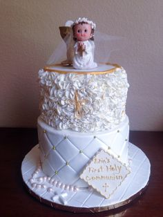 """- 8"""" and 6"""" with fondant decorations.  The prayer girl on top is ceramic doll provided by client.  Chalice and everything else is fondant."""