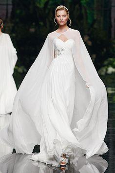 A dramatic #wedding cape from Pronovias. #WouldYouWearIt?