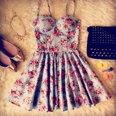Gorgeous floral printed summer mini dress with gold studded black hand bag and gold ladies shoes and cute gold chain the cute summer outfits