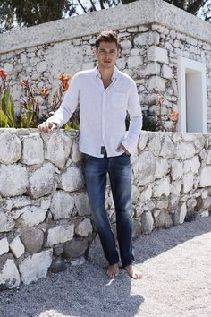 Dark denim with a clean white shirt is always an easy, winning look. Mavi men's Zach straight leg jeans is a universally flattering fit.