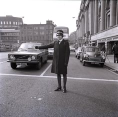 A Greater Manchester Police officer halting traffic in the city centre in 1974. This image must have been taken in the first few months of the existence of the Force, which came into being on 1 April that year. www.gmpmuseum.co.uk