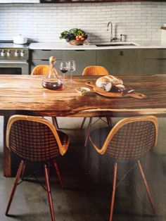 LOVE the table and chairs! So warm and inviting. Modern and rustic.