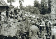 Fallschirmjager of the 14th Komp./III Fallschirm. Regt. boarding an Opel Blitz, Saint-Lô, France, July, 15, 1944.