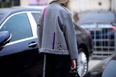 Russian blogger wearing grey jacket