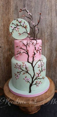 Cherry Blossom Cake - I always love the charm of a cherry-blossom-themed cake. This one is just lovely.
