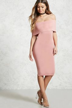 A stretch knit midi dress featuring an off-the-shoulder design with a foldover neckline, short sleeves, and a bodycon silhouette.