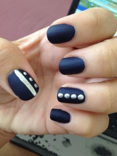 Matte blue nails with silver accents.