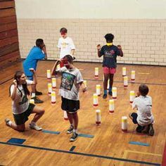 Minefield Game -- promoting trust and teamwork. Each team leader must guide their blindfolded partner through a maze of obstacles!
